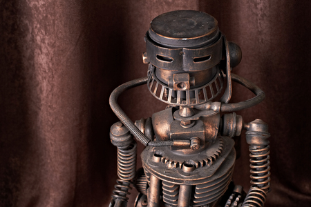 rust red: old mechanical robot on a brown background