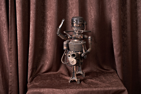 old mechanical robot on a brown background