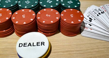 Set for poker on a wooden surface. Chips and cards for poker. Card games