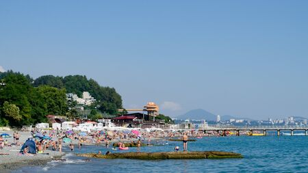 Sochi, Russia - July 7, 2019: people on the beach of Dagomys on a sunny day Редакционное