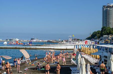 Sochi, Russia - July 20, 2019: the beach Primorsky in the morning, view of the port and breakwaters Редакционное