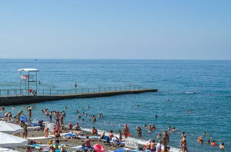 Sochi, Russia - July 20, 2019: Tourists bathe and sunbathe, beach vacation at the resort