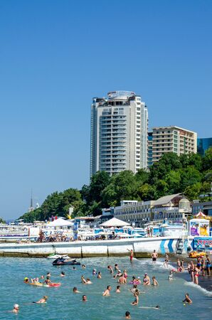 Sochi, Russia - July 20, 2019: residential complex Aleksandriyskiy Mayak and Apart-hotel Brevis towering over the beach