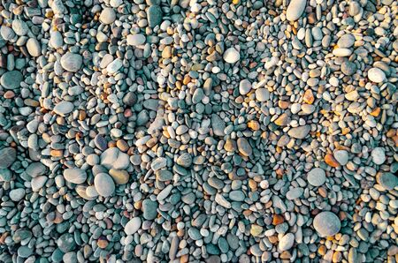 Abstract nature pebbles background. Blue small pebbles texture. Stone background. Various sea peblles beach. Turquoise color 스톡 콘텐츠
