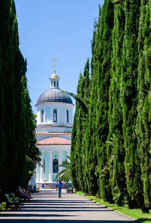 Sochi, Russia - July 20, 2019: Cypress Alley in the Cathedral of St. Michael the Archangel. Vertical frame