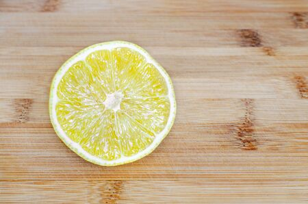 Sliced lemon on a wooden surface