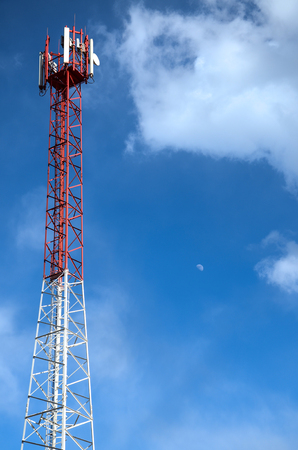 the firmament: Mobile communications tower against a clear sky and moon Stock Photo