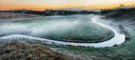 autumn morning. foggy dawn near a picturesque river