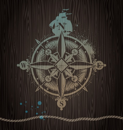 Vector compass rose painting on a wooden wall Stock Vector - 10768521
