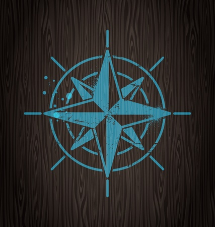 Vector compass rose painting on a wooden wall Stock Vector - 10768515