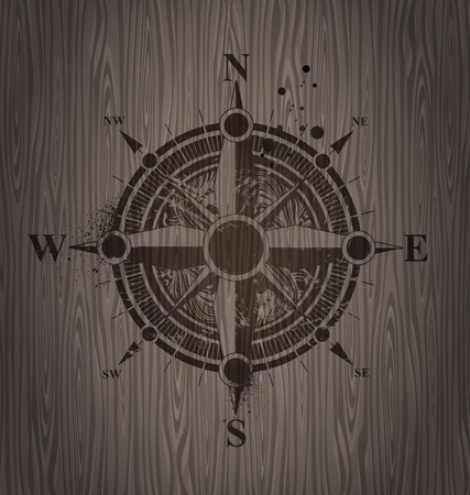 Vector compass rose painting on a wooden wall Vector