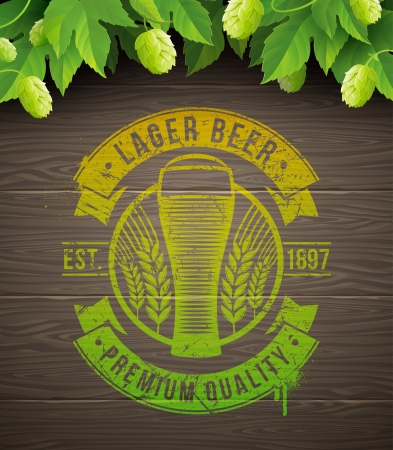on tap: Beer emblem painted on wooden surface and ripe hops and leaves - vector illustration