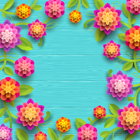 Artificial paper flowers on a blue wooden plank background with copy space in the center.
