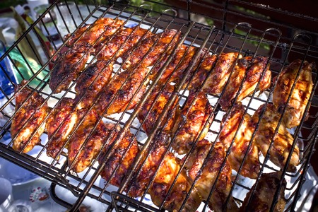 cattle grid: chef grilling lamb ribs on flame Stock Photo