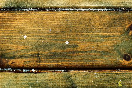 inducement: Old wooden background with falling snow flakes Stock Photo