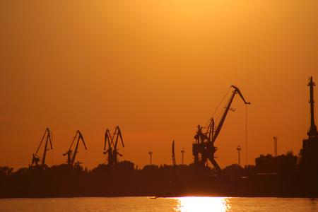 Novgorod. Volga river. cranes against a red sunset.