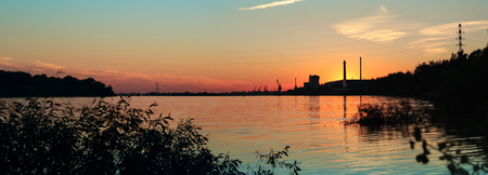 Panorama of the sunset on the river.
