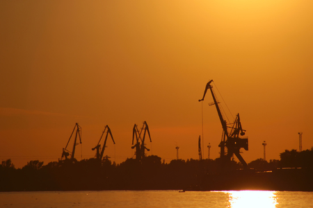 Novgorod. Volga river. cranes against a red sunset.