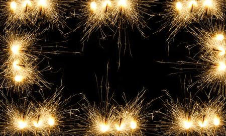 Burning Christmas sparkler isolated on black background. Bengal fire.