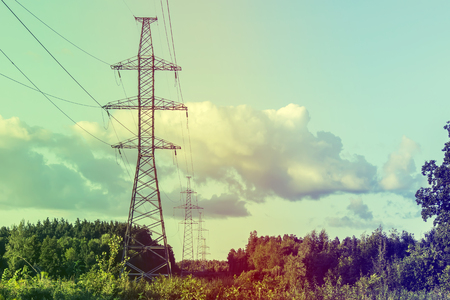 metal structure: high voltage post,High voltage tower sky sunset background Stock Photo