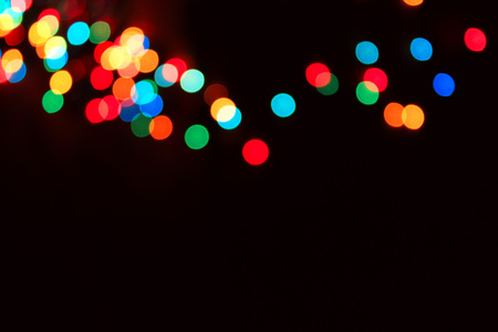 Various different multicoloured bubles close up in dark light background, festival and celebreties photo, nice bubbles,Christmas mood, New Year, celebrities mood, colorful light, light art