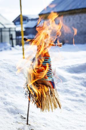 Burning of a doll during spring holiday of Maslenitsa Stock Photo