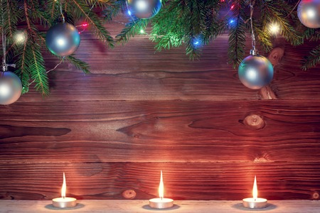 candle and christmas decorations on wooden background, christmas concepts