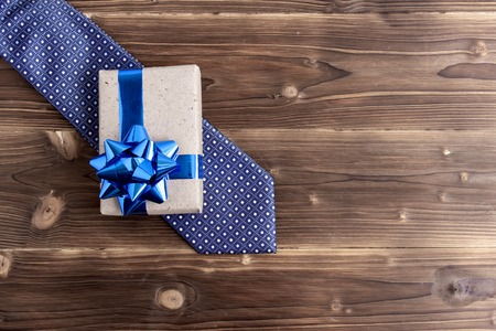 Happy Fathers Day with tie and watch on wooden background. Greetings and presents Stockfoto