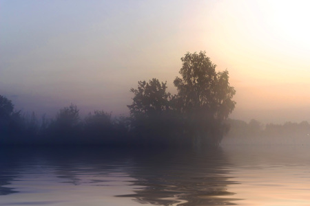 Rural early morning sunrise with lake, fog and russians landscape. Stock Photo