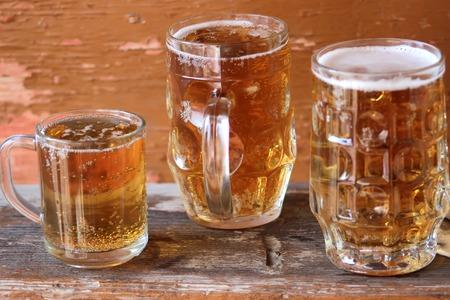Mug of beer on wooden background. Stockfoto