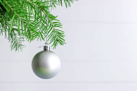 Christmas toy hanging on a branch of spruce decoration isolated on the white. Imagens
