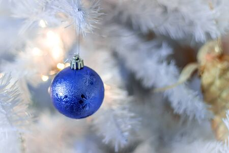 Blue bubble hanging on silver christmas tree, good as background 写真素材