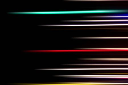 Horizontal multicolor light rays on a black background. Long exposure photo. Stockfoto - 129948017