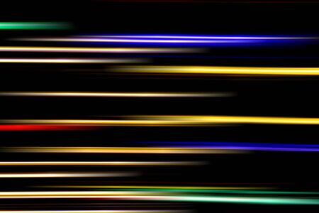 Horizontal multicolor light rays on a black background. Long exposure photo. Stockfoto - 129948018