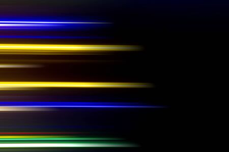 Horizontal multicolor light rays on a black background. Stockfoto