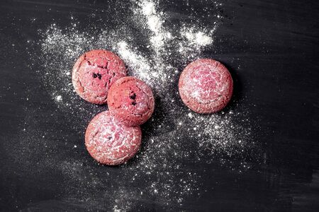 Chocolate red cookies on dark wooden table. Top view Stock Photo