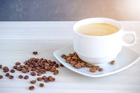 Coffee in cup and coffee beans, isolated spread on a white background
