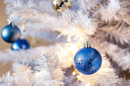 Blue ball hanging on silver christmas tree, good as background