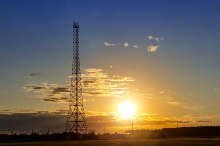 Communication tower against summer sunset background