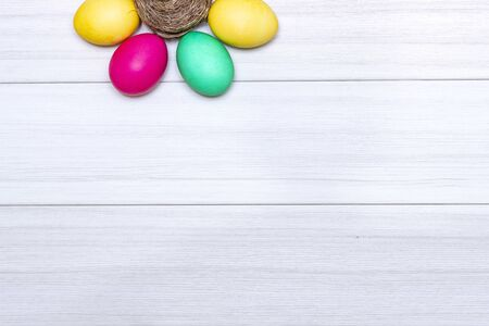 Easter eggs painted in pastel colors on a white wooden background 版權商用圖片