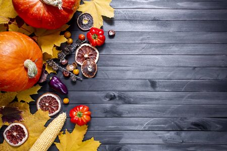 Thanksgiving background. Autumn background with pumpkin, candied oranges and copy space. Top view. 版權商用圖片