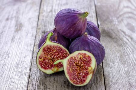 A fresh figs on old wooden background.