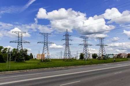 High voltage posts in scenic colourful summer landscape, industrial background Banco de Imagens