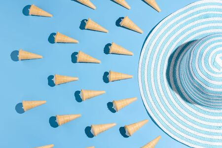 Ice cream cones on blue table. Summer background 写真素材