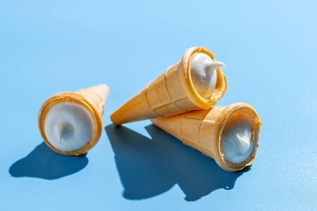 Ice cream cones on blue table. Summer background Фото со стока