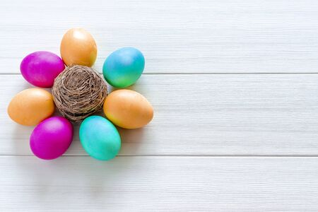 Easter eggs painted in pastel colors on a white wooden background Reklamní fotografie