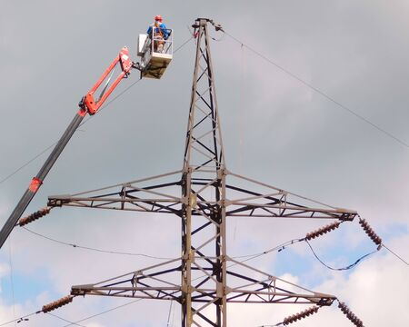 Electrician repair of electric power system on hydraulic platform