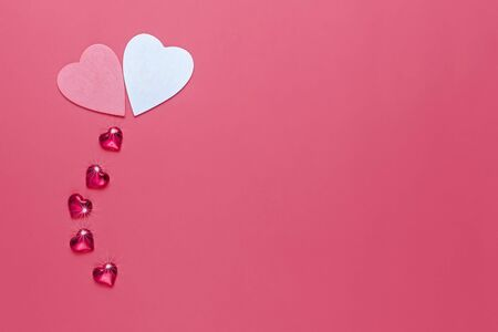 Valentines day background with two hearts on red background.