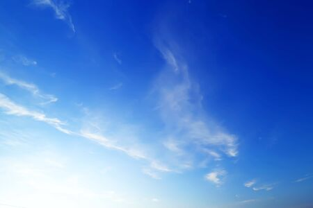 Blue sky with clouds. Natural abstract background