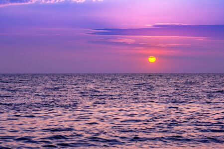 Beautiful sea sunset with pink colors